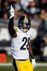 OAKLAND, CA - DECEMBER 09: Cornerback Mike Hilton #28 of the Pittsburgh Steelers celebrates after a sack against the Oakland Raiders during the second quarter at the Oakland Coliseum on December 9, 2018 in Oakland, California. The Oakland Raiders defeated the Pittsburgh Steelers 24-21. (Photo by Jason O. Watson/Getty Images) *** Local Caption *** Mike Hilton
