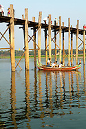 One of Burma's most distinctive sights, U Bein Bridge in the ancient city of Amarapura spans over one kilometer.  It is the world's longest teak bridge and one of Mandalay's top attractions.