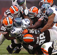The Browns defense stops Shaun Alexander of Seattle Nov. 4, 2007.