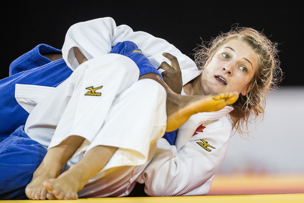 Kelita Zupancic of Canada pins Vanessa Chala of Ecuador in the women's judo -70 kg 1/4 final at the 2015 Pan American Games in Toronto, Canada, July 13,  2015.  AFP PHOTO/GEOFF ROBINS