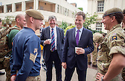 © Licensed to London News Pictures. 26/06/2014. London, UK The Deputy Prime Minister, NICK CLEGG (R), accompanied by ALISTAIR CARMICHAEL (L) the Secretary of State for Scotland visit F Company, part of the Scots Guards, at Wellington Barracks in London on Thursday 26 June to mark Armed Forces Day 2014. On the visit, they met the Guardmen in their line up, saw a weapons test and chatted to them as they prepared their kit ahead of going on exercise, They also saw Guardsmen preparing for the ceremonial side of their duties as The Queen's Guards.. Photo credit : Stephen Simpson/LNP