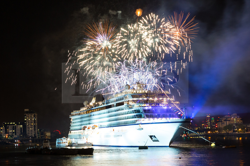 © Licensed to London News Pictures. 06/05/2016. LONDON, UK.  Fireworks explode and light up the night sky behind the Viking Sea cruise ship at Greenwich on the River Thames. The fireworks celebrate the chistening of the 930 passenger capacity liner which took place earlier today. Photo credit: Vickie Flores/LNP