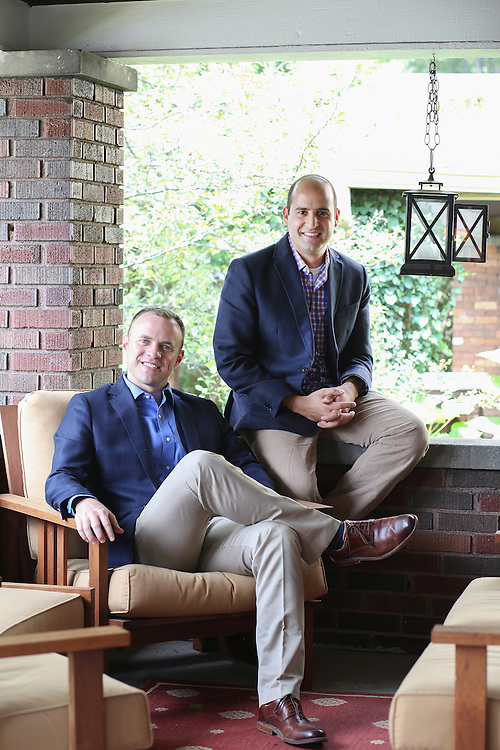 Patrick Herrel, left and George Srour sit on Herrel's porch. The pair are best friends and both on the Forbes 30 under 30 list. They live right across the street from each other and both attended William & Mary.