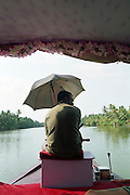 A Traditional Rice Boat on the Kerala Backwaters, India, Kerala, a state on the tropical coast of south west India
