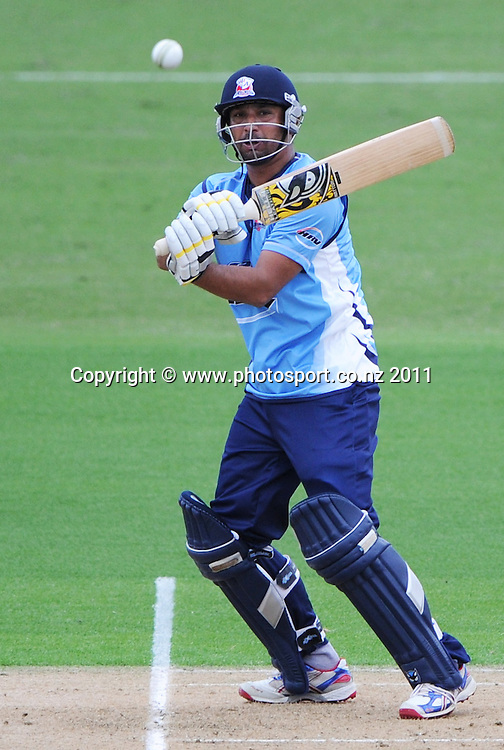 Azhar Mahmood batting during his century innings at the HRV Twenty20 Cricket match between the Auckland Aces and Canterbury Wizards at Colin Maiden Oval in Auckland, New Zealand on Tuesday 17 January 2012. Photo: Andrew Cornaga/Photosport.co.nz