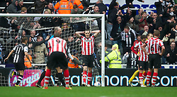 NEWCASTLE, ENGLAND - Sunday, March 4, 2012: Sunderland's John O'Shea looks dejected as Newcastle United score the equalising goal from the penalty spot during the Premiership match at St. James' Park. (Pic by David Rawcliffe/Propaganda)
