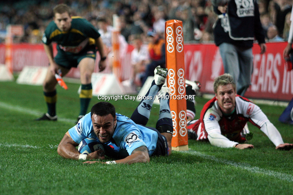 Sosene Anesi dives over to score a try. NSW Waratahs v Lions. Investec Super Rugby Round 14 Match, 21 May 2011. Sydney Football Stadium, Australia. Photo: Clay Cross / photosport.co.nz