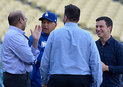 October 6, 2017 - Los Angeles, California, U.S. - Los Angeles Dodgers General Manager Farhan Zaidi, left, speaks with manager Dave Roberts as Andrew Friedman President of Baseball Operations smiles prior to a National League Divisional Series baseball game against the Arizona Diamondbacks at Dodger Stadium on Friday, Oct. 06, 2017 in Los Angeles. (Photo by Keith Birmingham, Pasadena Star-News/SCNG) (Credit Image: © San Gabriel Valley Tribune via ZUMA Wire)
