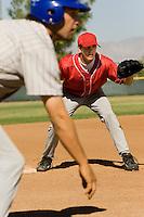 Baseball Fielder and Runner Waiting For Play
