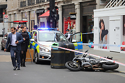 © Licensed to London News Pictures. 05/06/2018. London, UK. Police are seen at the Watches of Switzerland jewellery shop in Regent Street after it was attacked by a gang on mopeds. It is being reported that the attackers were armed with knives. Photo credit: Rob Pinney/LNP