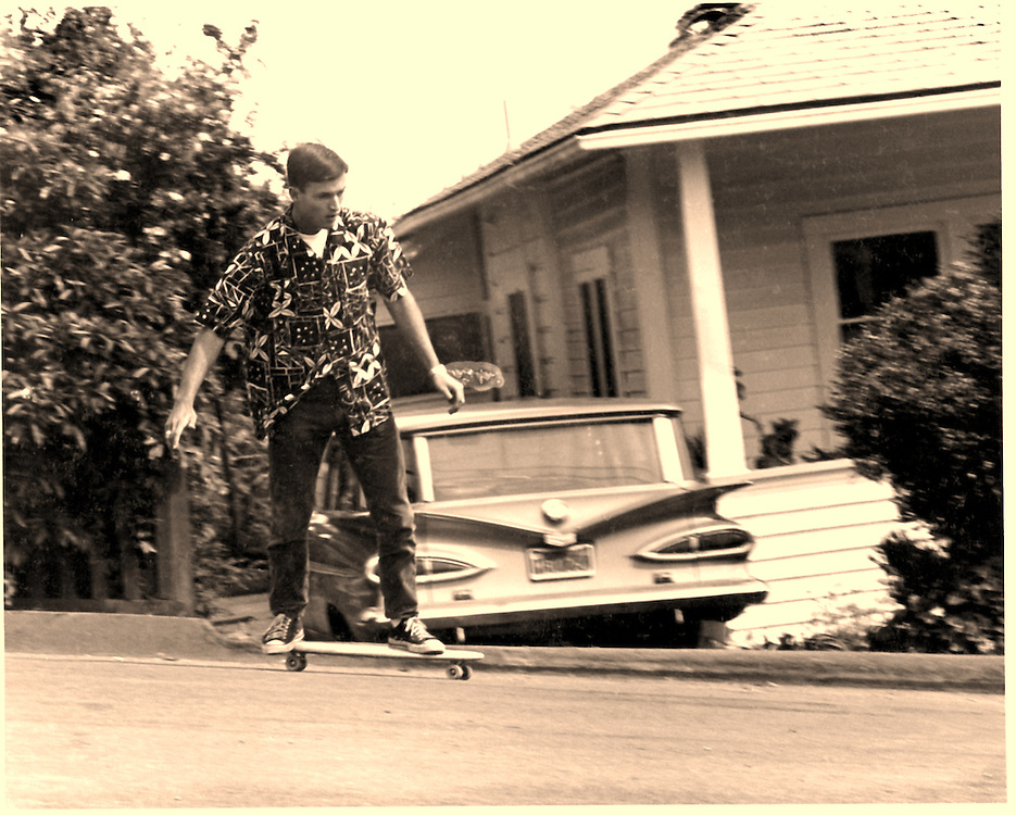 Dave Young heads down the hill right behind Jeff Whites shop in Summerland in 1966. There were lots of asphalt burns back then,.