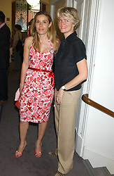 Left to right, TANA RAMSAY wife of Gordon Ramsay and LADY BRUCE DUNDAS at a charity event 'In The Pink' a night of music and fashion in aid of the Breast Cancer Haven in association with fashion designer Catherine Walker held at the Cadogan Hall, Sloane Terrace, London on 20th June 2005.<br />