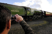 United Kingdom, Kidderminster, 25 October 2009: A railway enthusiast photographs the Tornado arriving at Kidderminster station on the Severn Valley Railway. The Tornado is a Peppercorn class A1 Pacific steam locomotive. Photo by Peter Horrell / http://peterhorrell.com...