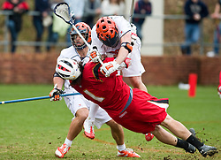 Virginia Cavaliers M Max Pomper (42) checks Maryland Terrapins Attack Grant Catalino (1).  The #9 ranked Maryland Terrapins fell to the #1 ranked Virginia Cavaliers 10 in 7 overtimes in Men's NCAA Lacrosse at Klockner Stadium on the Grounds of the University of Virginia in Charlottesville, VA on March 28, 2009.