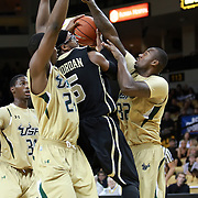 Central Florida guard Marcus Jordan (5) drives to the basket against Augustus Gilchrist (24) and Toarlyn Fitzpatrick (32) during the NCAA basketball game against the USF Bulls at the UCF Arena on November 18, 2010 in Orlando, Florida. UCF won the game 65-59. (AP Photo/Alex Menendez)
