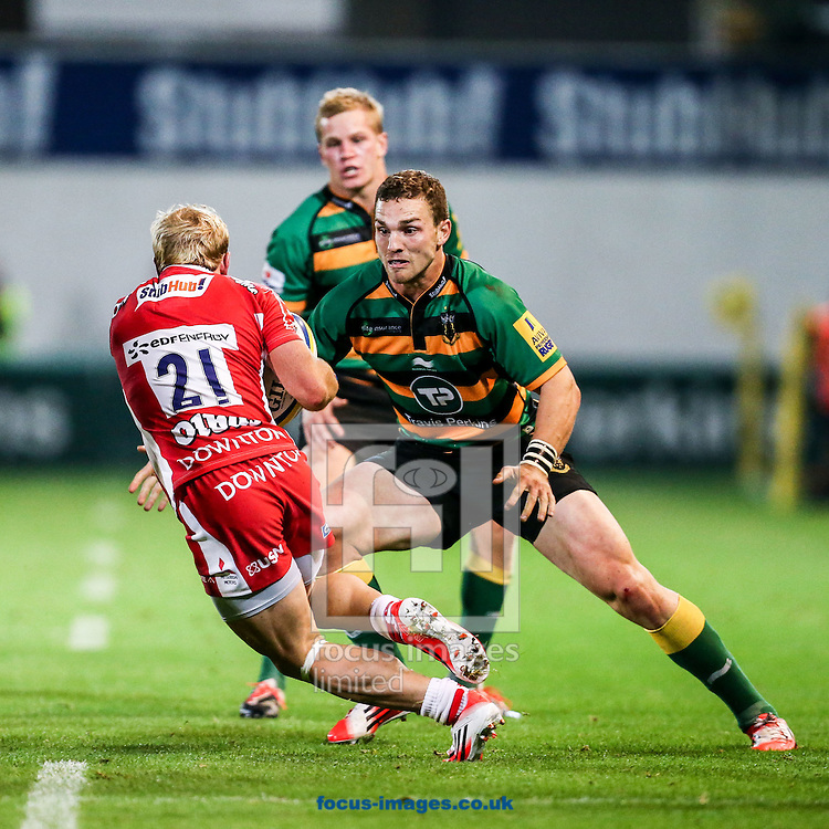 George North of Northampton Saints (centre) prepares to tackle  Dan Robson of Gloucester Rugby during the Aviva Premiership match at Franklin's Gardens, Northampton<br /> Picture by Andy Kearns/Focus Images Ltd 0781 864 4264<br /> 05/09/2014