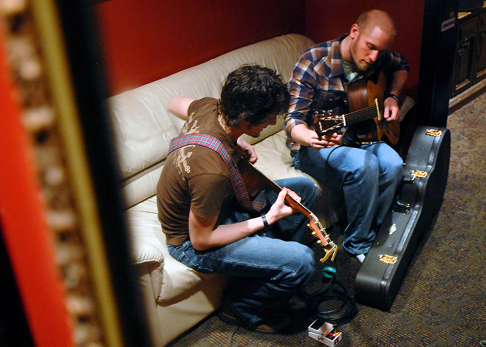 Zachary J. and John Roush, both of Rockville, warm-up back stage before performing during an open mic night at Jammin' Java in Vienna.