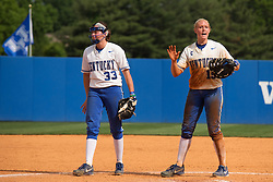 UK first baseman Lauren Cumbess, left, calls time out to get a towel for pitcher Kelsey Nunley. The University of Kentucky Softball team hosted Virginia Tech in KY Regional Championship Game of the 2013 NCAA D1 Softball Tournament, Sunday, May 19, 2013 at John Cropp Stadium in Lexington. Photo by Jonathan Palmer