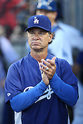 LOS ANGELES, CA - AUGUST 22:  Manager Don Mattingly #8 of the Los Angeles Dodgers claps his hands as the lineups are called out on the public address system before the game against the New York Mets at Dodger Stadium on Friday, August 22, 2014 in Los Angeles, California. The Dodgers won the game 6-2. (Photo by Paul Spinelli/MLB Photos via Getty Images) *** Local Caption *** Don Mattingly