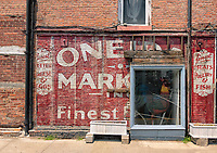 Old store name painted on the side of a brick building in Hudson, New York, U.S.A.