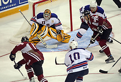 Players of Latvia vs Goalkeeper Tim Thomas at ice-hockey match USA vs Latvia at IIHF WC 2008 in Halifax,  on May 02, 2008 in Metro Center, Halifax, Canada.  (Photo by Vid Ponikvar / Sportal Images)
