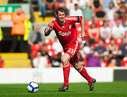 LIVERPOOL, ENGLAND - Sunday, April 11, 2010: Liverpool's Jamie Carragher in action against Fulham during the Premiership match at Anfield. (Photo by: David Rawcliffe/Propaganda)