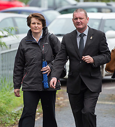 © Licensed to London News Pictures.  14/08/2017; Taunton, Somerset, UK. Avon and Somerset PC CLAIRE BODDIE (short brown hair carrying blue brolly), age 47, appears at Taunton Magistrates Court charged with common assault after Avon and Somerset race relations group founder Judah Adunbi, 63, was Tasered in Bristol on 14 January. Mr Adunbi, who was Tasered in Colston Road, Easton, is the founding member of an independent group between the police and prominent members of the African-Caribbean community. Picture credit : Simon Chapman/LNP