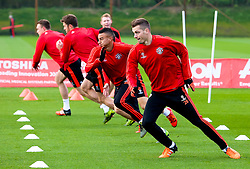 Morgan Schneiderlin of Manchester United warms up with Jesse Lingard, Michael Carrick and Phil Jones - Mandatory byline: Matt McNulty/JMP - 07966386802 - 20/10/2015 - FOOTBALL - Aon Training Complex -Manchester,England - UEFA Champions League