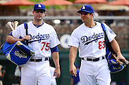 GLENDALE, AZ - MARCH 05:  Alex Hassan #75 and Rob Segedin #83 of the Los Angeles Dodgers walk to the field for the spring training game against the Arizona Diamondbacks at Camelback Ranch on March 5, 2016 in Glendale, Arizona.  The Dodgers won 7-2.  (Photo by Jennifer Stewart/Getty Images) *** Local Caption *** Alex Hassan; Rob Segedin