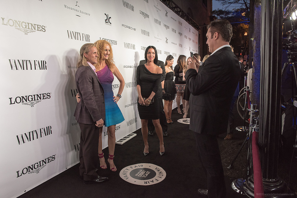 Hotel guests arriving are photographed with their phones by Boxcar Public Relations on the black carpet at the Vanity Fair Derby party at 21c Museum Hotel. May 6, 2016