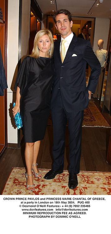 CROWN PRINCE PAVLOS and PRINCESS MARIE CHANTAL OF GREECE, at a party in London on 18th May 2004.PUG 400