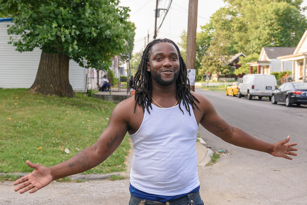 Markell Carter laughs as Eddie Woods, director of Street Peace: No More Red Dots, kids him Monday, June 20, 2016 near Whitey's Grocery in the Parkland neighborhood. (Photo by Brian Bohannon)