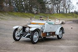 © Licensed to London News Pictures. 28/01/2018. Weybridge, UK. Competitor Katie Forrest drives a 1912 Rolls-Royce Silver Spirit on the moss covered historic banked track at Brooklands Museum as she takes part in The Vintage Sports-Car Club's New Year driving tests.  Photo credit: Peter Macdiarmid/LNP