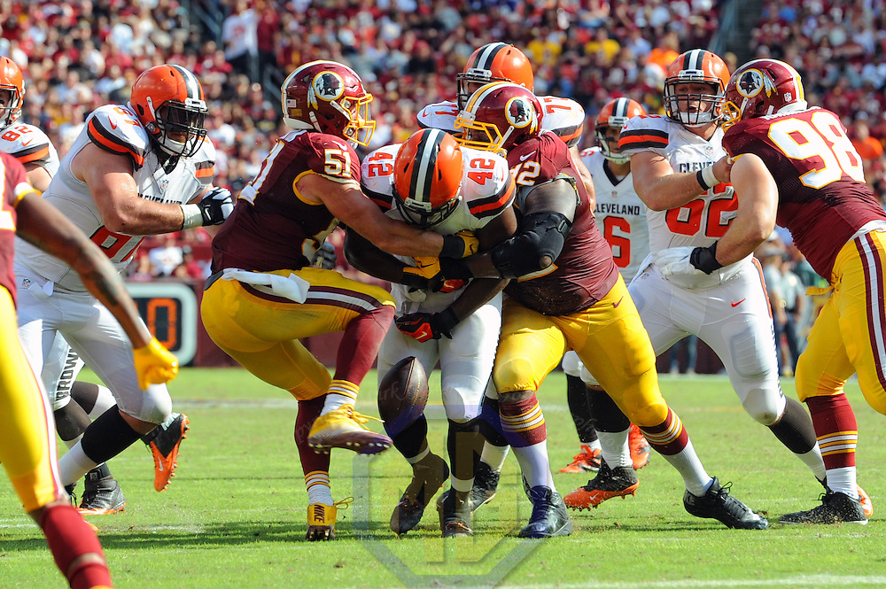 02 October 2016:   Cleveland Browns fullback Malcolm Johnson (42) fumbles the ball on a tackle by Washington Redskins inside linebacker Will Compton (51) and defensive end Chris Baker (92) at FedEx Field, in Landover, MD. where the Washington Redskins defeated the Cleveland Browns, 31-20. (Photo by Mark Goldman/Icon Sportswire)