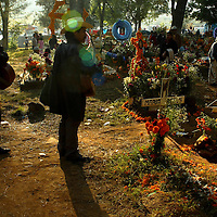 Mexicans celebrate this day, known as 'Day of the Dead,' to pay homage to their dead relatives, preparing meals and decorating their graves as an offering. This tradition is based in pre-Hispanic culture..------------.Spanish:.Celebraciones del Dia de muertos en el estado de Michoacan, en MŽxico, donde desde hace cientos de a–os se viene festejando cada 2 de Noviembre el dia de los santos inocentes, conviviendo con sus antepasados fallecidos, les llevan la que era su comida favorita, o su musica, adornan sus tumbas con miles de flores y los panteones se llenan de alegria. Pasan la noche en vela generalmente familias enteras recordando a sus difuntos..Fotos: Bernardo De Niz