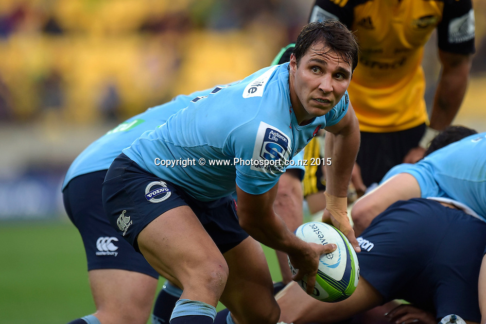 Waratahs' Bernard Foley passes out the ball during the Super Rugby - Hurricanes v Waratahs rugby union match at the Westpac Stadium in Wellington on Saturday the 18th of April 2015. Photo by Marty Melville / www.Photosport.co.nz
