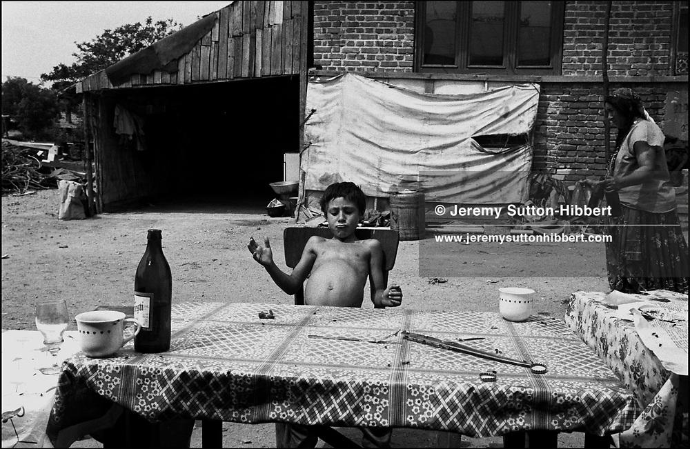 SIMIONE MIHAI PLAYS WITH HIS STOMACH, SINTESTI, ROMANIA,  1994..©JEREMY SUTTON-HIBBERT 2000..TEL./FAX. +44-141-649-2912..TEL. +44-7831-138817.