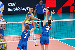 PARIS, FRANCE - SEPTEMBER 29: Klemen Cebulj #18 of Slovenia spikes the ball against Uros Kovacevic #2 and Marko Podrascanin #18 of Serbia during the EuroVolley 2019 Final match between Serbia and Slovenia at AccorHotels Arena on September 29, 2019 in Paris, France. Photo by Catherine Steenkeste / Sipa / Sportida