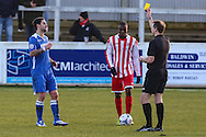 Jack Ainsley of Lowestoft Town (left) is booked by Referee, Mr Declan Ford, during the Conference North match at St. James Park, Brackley<br /> Picture by David Horn/Focus Images Ltd +44 7545 970036<br /> 24/01/2015