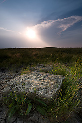Limestone, like this piece photographed at sunset on the prairie at the Tallgrass Prairie National Preserve in the Kansas Flint Hills, is a common sight and the reason for the survival of the tallgrass prairie in the Flint Hills. Prairie soil is heavily laden with limestone and chert (commonly called flint) making it unsuitable for plowing. This rocky soil, combined with a cycle of wildfires and animal grazing has preserved the tallgrass prairie. The 10,894-acre Tallgrass Prairie National Preserve is located in Chase County near the towns of Strong City and Cottonwood Falls. Less than four percent of the original 140 million acres of tallgrass prairie remains in North America. Most of the remaining tallgrass prairie is in the Flint Hills in Kansas. Tallgrass Prairie National Preserve is the only unit of the National Park Service dedicated to the preservation of the tallgrass prairie ecosystem. The Tallgrass Prairie National Preserve is co-managed with The Nature Conservancy.