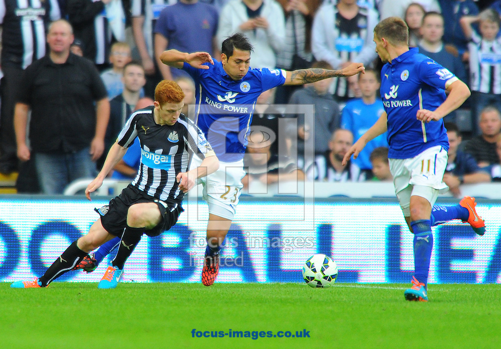 Leonardo Ulloa of Leicester City (centre) battles with Jack Colback of Newcastle United (left) during the Barclays Premier League match at St. James's Park, Newcastle<br /> Picture by Greg Kwasnik/Focus Images Ltd +44 7902 021456<br /> 18/10/2014