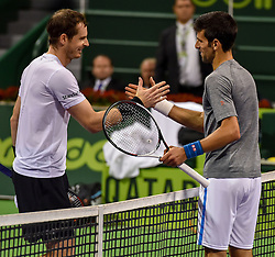 Novak Djokovic of Serbia  (R)  shakes hands with Andy Murray of Great Britain(L)  after winning during their tennis match on the final match at the Qatar ATP Open Tennis tournament  at the Khalifa International Tennis Complex in Doha, capital of Qatar, on January 07, 2017. Novak Djokovic won the title 2-1  (Credit Image: © Nikku/Xinhua via ZUMA Wire)