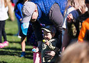 Matthew Pertl, 1, grabs an egg before the start of the 21st Annual Easter Egg Hunt at Winnequah Park in Monona, WI on Saturday, April 20, 2019.