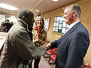 Mayor Peter Corroon, right, speaks with Fred Ntabwoba, a refugee from Rwanda at the Salt Lake County Government Center, Tuesday, Dec. 4, 2012.