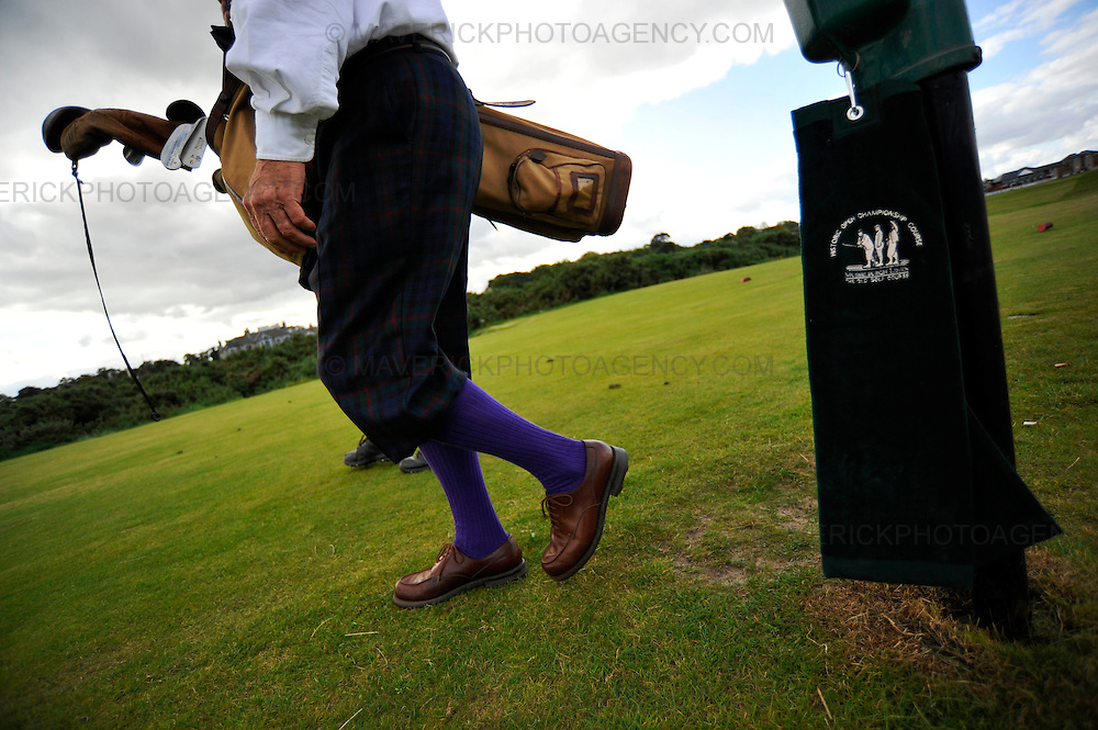 MUSSLEBURGH, UNITED KINGDOM - 20th SEPTEMBER 2009.  Golfers in period 1930's attire with hickory shafted clubs take part in the Mussleburgh International Hickroy Open held at Mussleburgh Old Links course, the oldest playing golf course in the world which dates back to 1672.  The event marks day one of a weeks hickroy golfing leading up to the PGA World Hickory Open Championships 23rd - 25th September which attracts Pro-Am golfers from around the world.