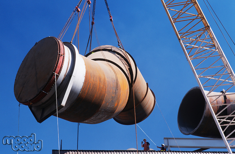 Installing fume extraction pipe into steel foundry smelter