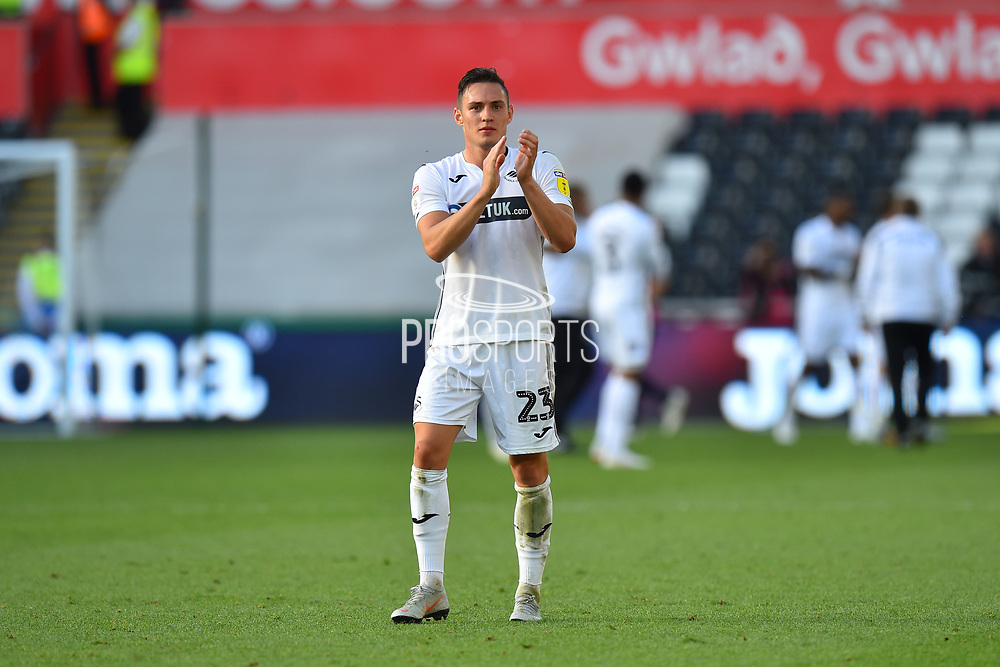 Goalscorer Connor Roberts (23) of Swansea City applauds the fans at full time after the 3-0 win over QPR during the EFL Sky Bet Championship match between Swansea City and Queens Park Rangers at the Liberty Stadium, Swansea, Wales on 29 September 2018.