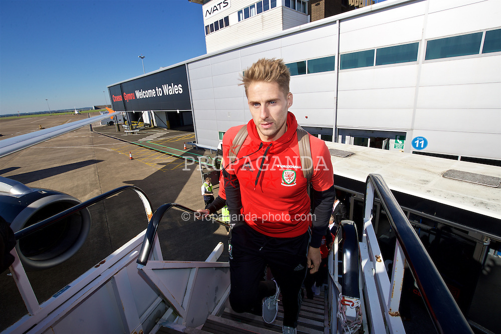 CARDIFF, WALES - Wednesday, October 5, 2016: Wales' David Edwards boards the team plane at Cardiff Airport as the team travel to Vienna ahead of the 2018 FIFA World Cup Qualifying Group D match against Austria. (Pic by David Rawcliffe/Propaganda)