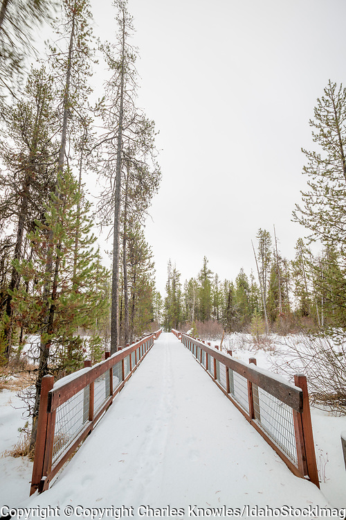 Wooden foot bridge in winter with ski tracks on it, McCall.