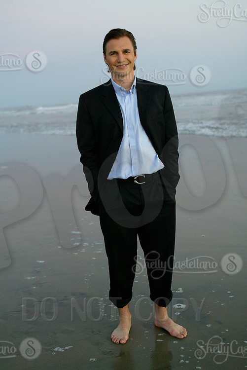 Aug 20, 2003; Newport Beach, California, USA; NHL Anaheim Mighty Ducks newest centermen SERGEI FEDOROV visits the Pacific Ocean in a suit while searching for a new home in Southern California. Fedorov means business after agreeing to a 5 year deal to play professional Ice Hockey for the Ducks after leaving the Detroit Red Wings after the 2002-2003 season. Former Russian Hockey player for the Central Red Army.  X-husband of Russian tennis star ANNA KOURNIKOVA. Mandatory Credit: Photo by Shelly Castellano/ZUMA Press. (©) Copyright 2003 by Shelly Castellano